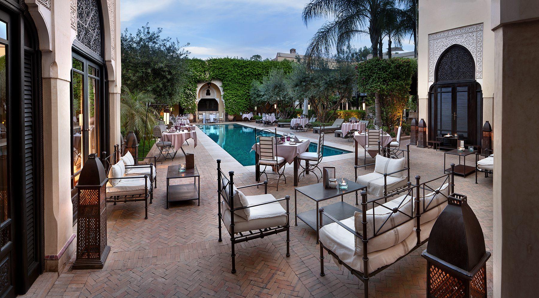 Dinner by the pool Villa des Orangers